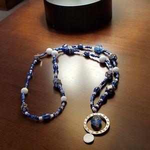 Handcrafted badge/key holder necklace